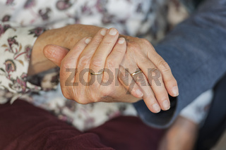 Hands of an 80 year old married couple