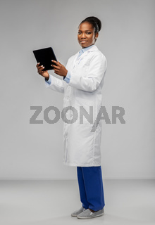 african american female doctor with tablet pc