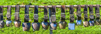 many cow bells hanging in a row