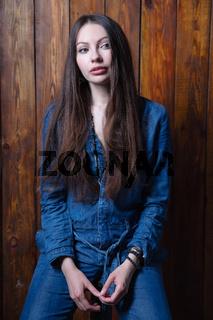Charming brunette dressed in denim overalls