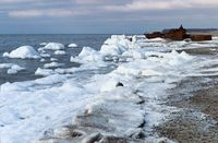 the sea is frozen, pierce in the ice, the sea coast in the ice winter on the Baltic sea, icing on th