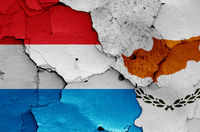 flags of Luxembourg and Cyprus painted on cracked wall