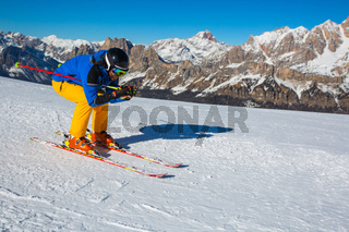 Alpine skier on slope at Cortina