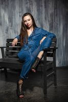 Nice young woman dressed in denim overalls
