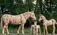 Putgarten, Rügen, Germany - september 1, 2018 - driftwood horses along the street