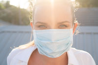 Portrait of woman in protective mask against flu and viruses outdoors