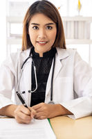 female doctor portrait sign document