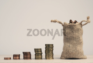 Stacked coins on a table, financial concept