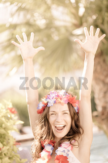 Happy woman enjoying sun on the beach