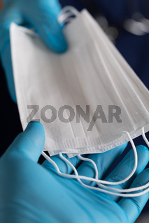 Doctors or Nurses Wearing Surgical Gloves Handing Over Medical Face Masks