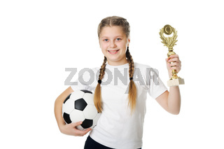 Little girl holding football ball and trophy isolated on white