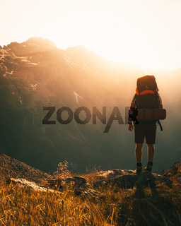 hiker with backpack in the mountains - austrian alps in summer