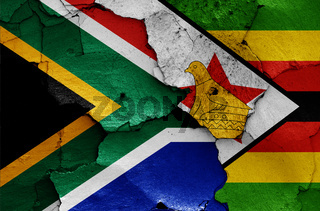 flags of South Africa and Zimbabwe painted on cracked wall