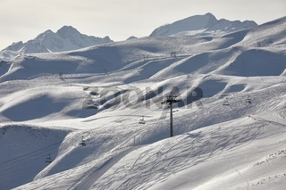 Skiing slopes, snowy Alpine landscape