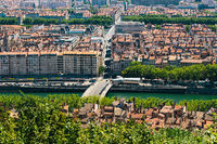 Lyon panorama elevated view on sunny day. Aerial panoramic view of Lyon with the skyline. Top view of Lyon cityscape with Pont Marechal Juin and Rhone river from Fourviere Hill