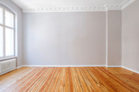 empty apartment room with wooden floor and stucco ceiling