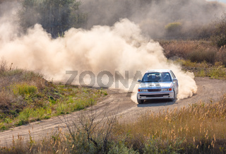 One Rally Car and a lot of Dust on a Sharp Turn