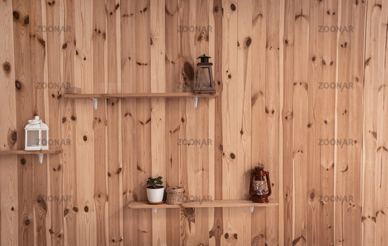 Old lamps or Retro lantern and pot with ivy plant on shelves at wooden wall. Front view. Abstract background or wallpaper