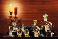 Candlelight and vintage perfume bottles