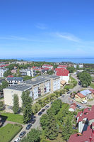 Panorama of Wladyslawowo town from above with streets houses cars and sea. View of town of Wladyslaw