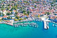 Tourist town of Selce waterfront aerial view