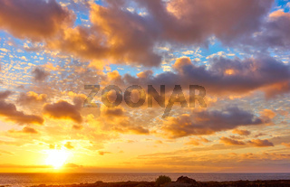 Sky with clouds above the Atlantic Ocean at sunset