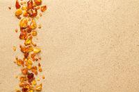 Ambers On Sea Sand Background