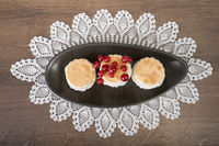 3 coconut tarts with currants