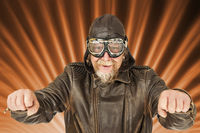 Fun motorcyclist posing on radiating background