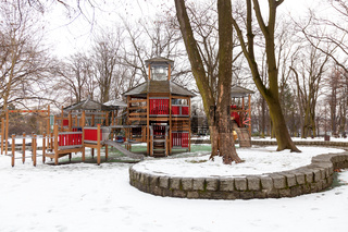 Modern wooden playground for young children during winter season.