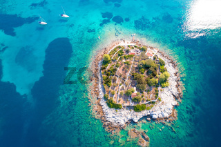 Aerial view of lonely island in Gradina bay, sailing destination on island Korcula
