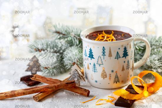 Mug of hot chocolate with cinnamon and orange zest.