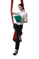 Smiling businesswoman with document on aerial silks