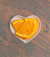 Orange in a white bowl for food photography