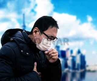 Asian  man suffer from cough with face mask protection