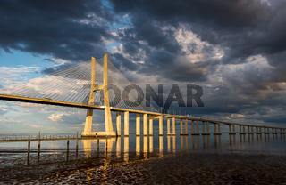 Vasco da Gama Bridge at sunset in Lisbon, Portugal