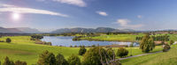 panoramic scene in Bavaria with lake and mountain range