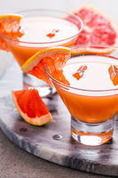 Fresh pink grapefruit drink with juice. Cold summer citrus refreshing drink or beverages with ice.