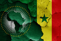 flags of African Union and Senegal painted on cracked wall