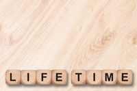 life time written on wooden cubes