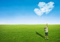 boy field clouds in shape of heart