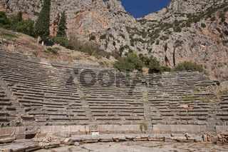 Panoramic view of Ancient Theater of Delphi, Phocis in Greece. The theater, with a total capacity of 5,000 spectators, is located at the sanctuary of Apollo. UNESCO World heritage