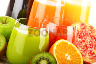 Composition with glasses of assorted fruit juices. Detox diet
