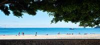 People tourists enjoy warm weather on Palma Nova sandy beach beautiful place, bright colors. Spanish Balearic island of Mallorca, municipality of Calvia. Travel and tourism, vacation concept