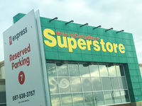 Calgary Alberta, Canada. Oct 17, 2020. The real canadian superstore building with the PC express reserved Parking for picking up groceries.