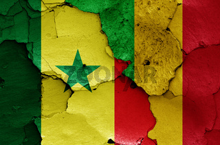 flags of Senegal and Mali painted on cracked wall