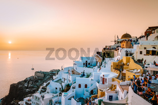 Santorini Oia Greece Europe, sunset at the white village of Oia Santorini with old blue and white Greek churches at dusk