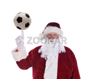 Santa Claus with his index finger pointing up with a soccer ball balanced on the tip, isolated on white