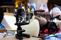 old black microscope exposed in an antiques market