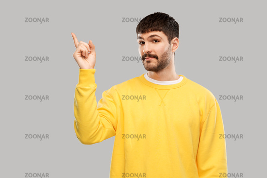 man pointing finger to something
